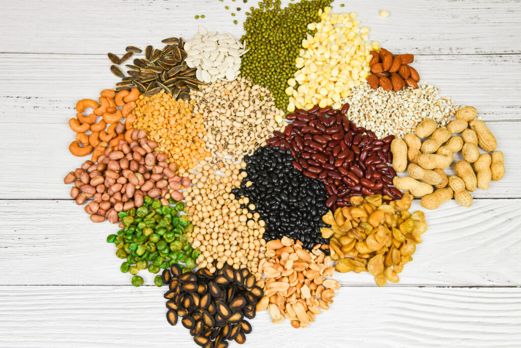 Set of different whole grains beans and legumes seeds lentils and nuts colorful snack texture background / Various beans mix peas agriculture of natural healthy food for cooking ingredients